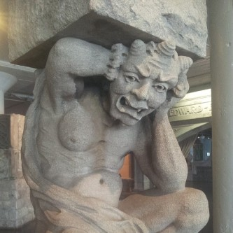 Statue of a groaning man under a burden, from the St. Louis City Museum