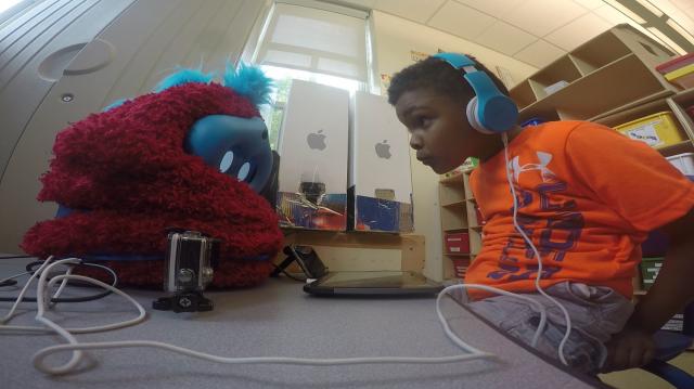 Tega, a robot tutor, with student